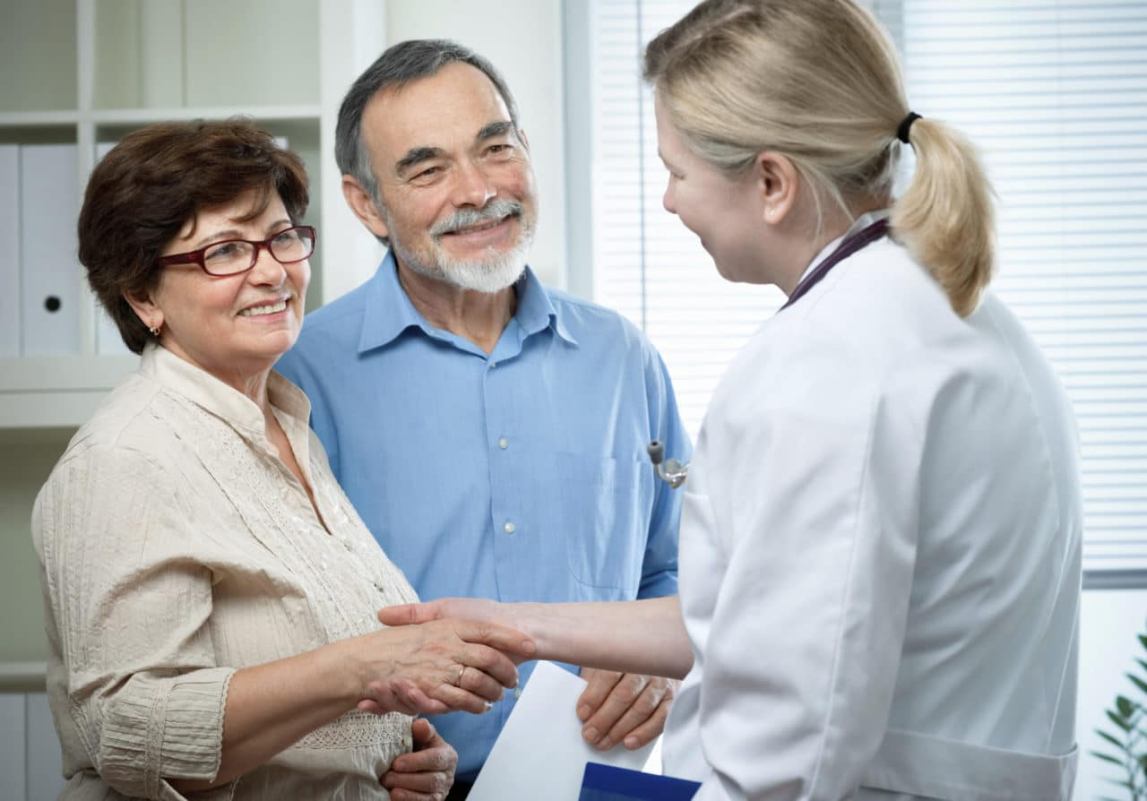 Older couple visiting with an audiologist