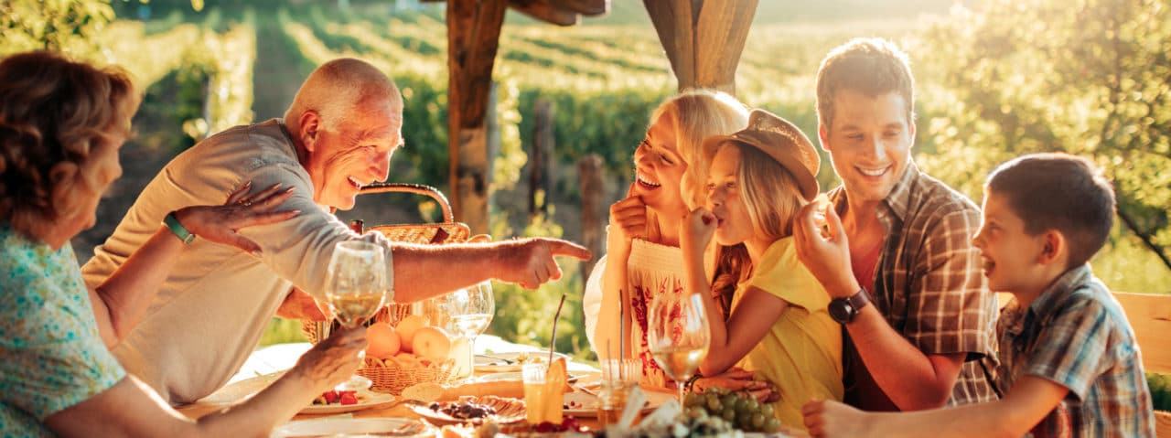 A family enjoying a meal around a table