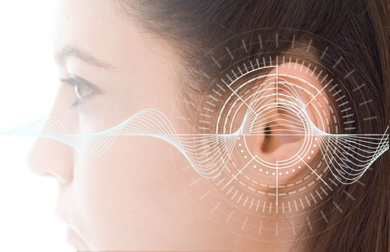 Sound waves over woman's ear