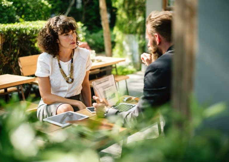 A man and woman communicating in a meeting