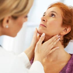 Doctor checking patients tonsils