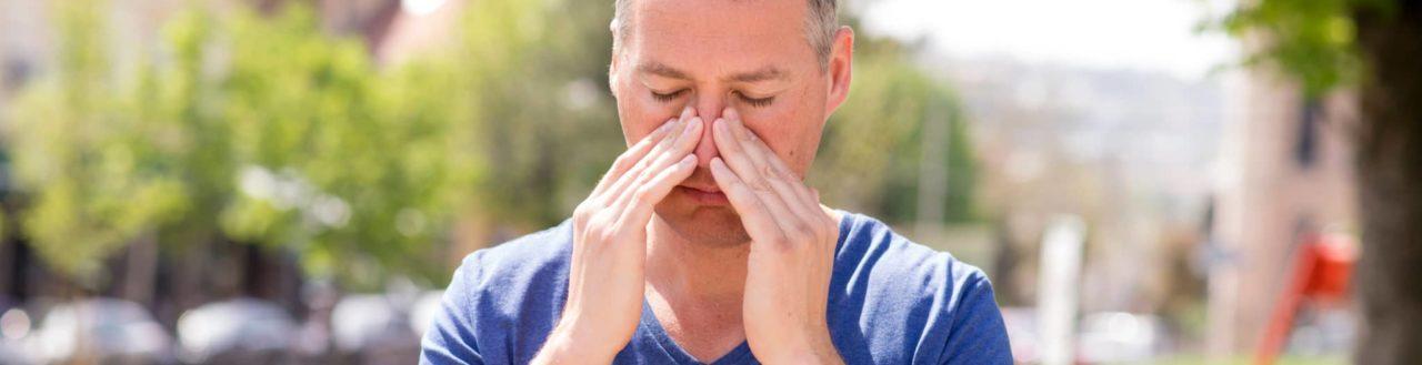 Man holding his nasal ridge